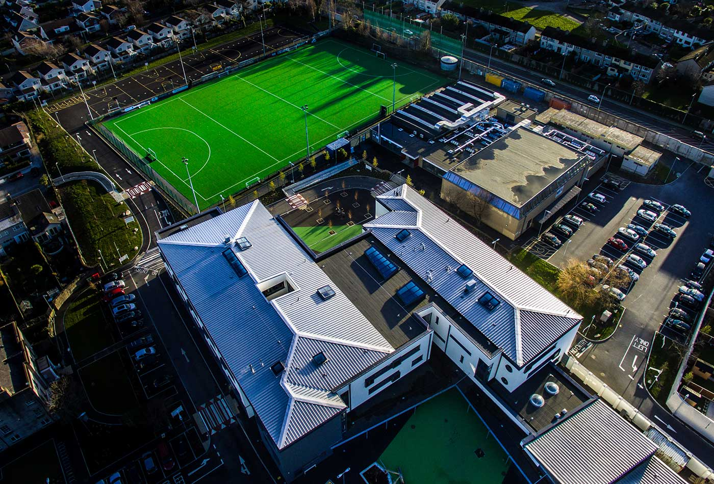 New buildings, hockey pitch and the sports centre.